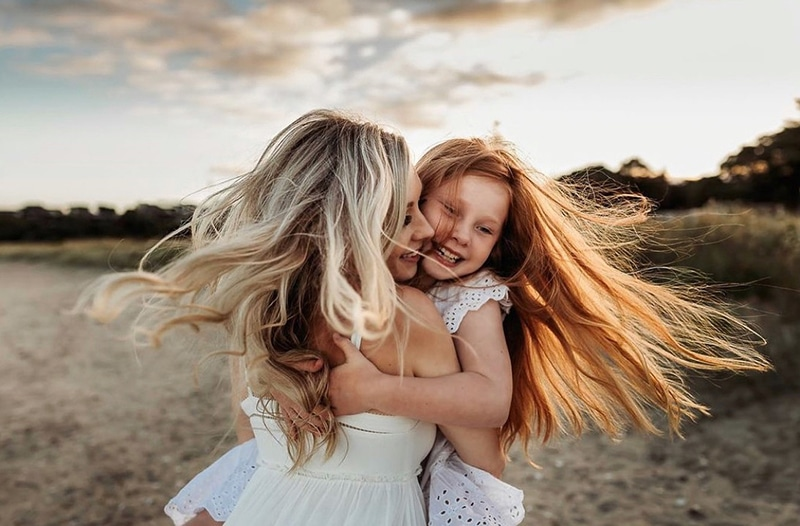 Mom and Daughter in the wind | All Heart Access