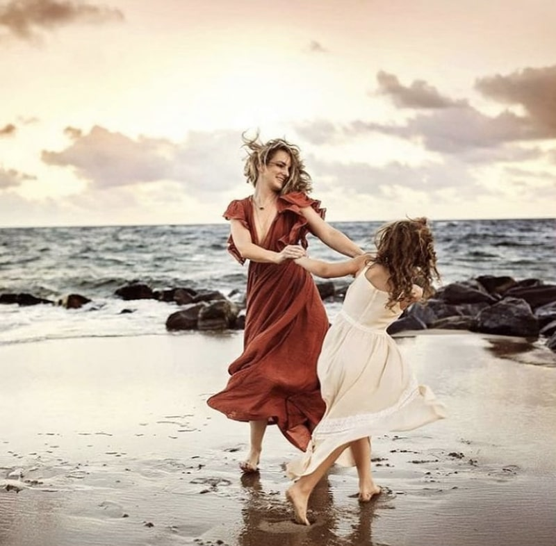 Mom and daughter dancing on the beach | AHA